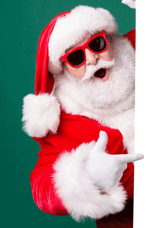 Santa pointing at a blue wall